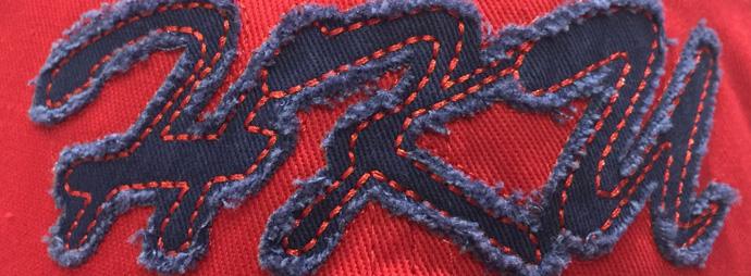 Raw edge applique with heavy stitches