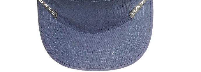 Wider flat bill visor with reverse binding