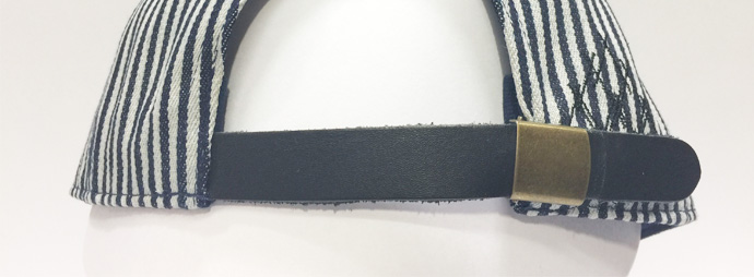 metal clasp with leather strap closure